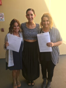 Dana and Ashley with Colton getting their certificates