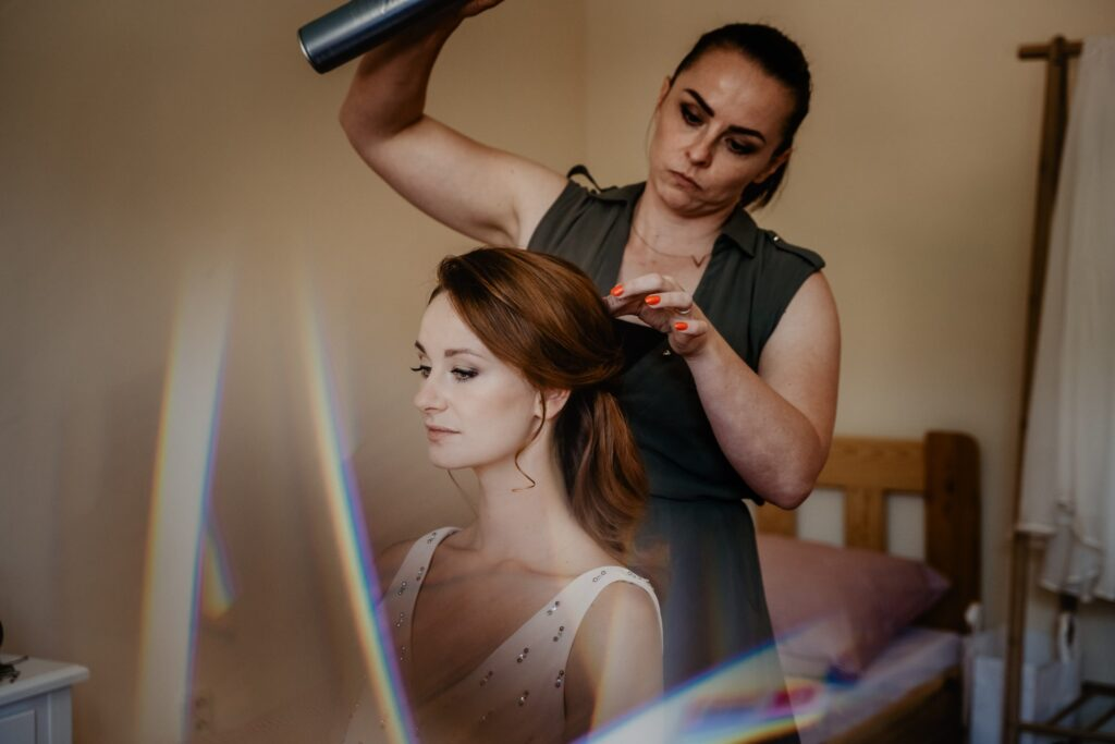 Hairdresser styling a woman's hair.
